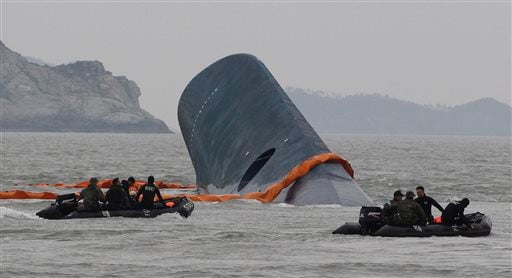 South Korean Coast Guard officers search for missing passengers aboard a sunken ferry in the waters off the southern coast near Jindo, South Korea on Thursday, April 17, 2014. (AP)