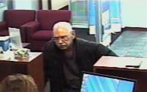 This Feb. 9, 2013 file surveillance photo provided by the FBI shows 73-year-old Walter Unbehaun, an ex-convict from Rock Hill., S.C., during a bank robbery in Niles, Ill. (AP Photo/FBI, File)