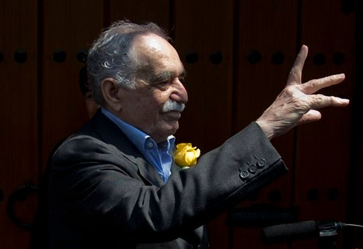 In this March 6, 2014 photo, Colombian Nobel Literature laureate Gabriel Garcia Marquez greets fans and reporters outside his home on his 87th birthday in Mexico City.