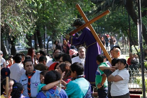 People who were participating in a Holy Week procession stop after a strong earthquake jolted Mexico City, Friday, April 18, 2014.