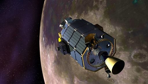 In this artist's concept provided by NASA, the Lunar Atmosphere and Dust Environment Explorer (LADEE) spacecraft orbits the moon.