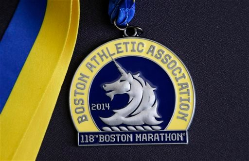 In this Thursday, April 10, 2014 photo, a medal for the 118th Boston Marathon is displayed in Boston.
