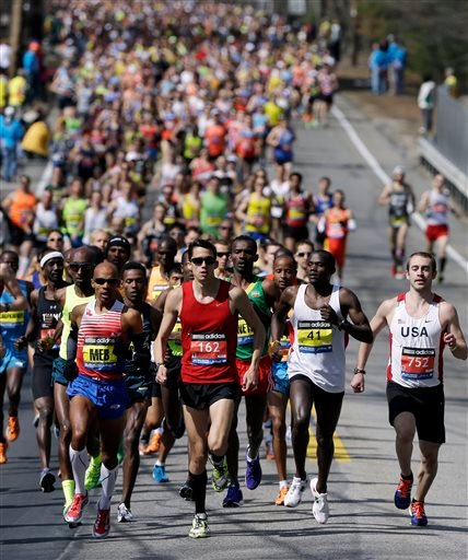 The elite men compete in the 118th Boston Marathon Monday, April 21, 2014 in Hopkinton, Mass.