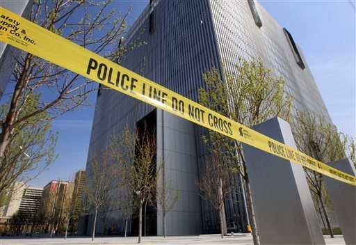 Police tape surrounds the Federal Courthouse Monday, April 21, 2014, in Salt Lake City.