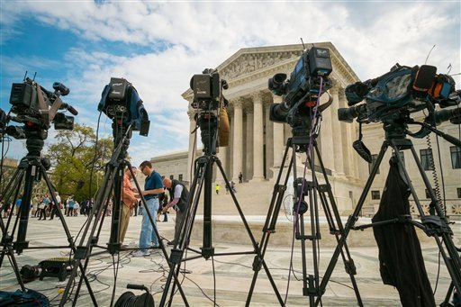 Videojournalists set up outside of the Supreme Court in Washington, Tuesday, April 22, 2014.(AP Photo/J. David Ake)