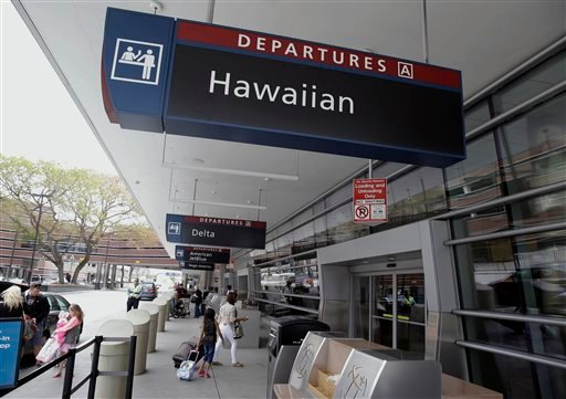 People make their way into Terminal A at Mineta San Jose International Airport near the Hawaiian Airlines gates Monday, April 21, 2014, in San Jose, Calif. (AP)