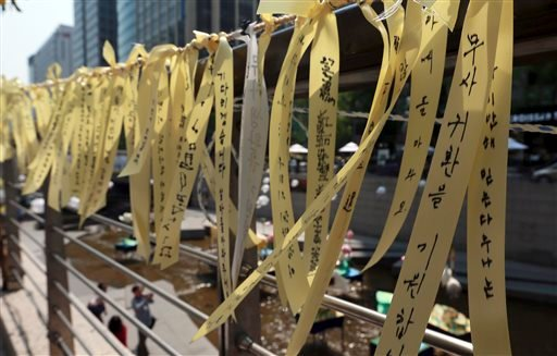 Yellow ribbons are displayed as a sign of hope for safe return of passengers of the sunken ferry boat Sewol in the of fence along the Cheonggye stream in Seoul, South Korea April 23, 2014.(AP Photo/Shin Jun-hee, Yonhap)