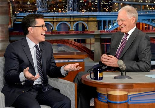 """In this photo provided by CBS, Comedy Central's Stephen Colbert, left, joins host David Letterman on the set of the """"Late Show with David Letterman,"""" Tuesday, April 22, 2014, in New York."""