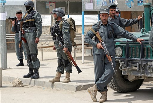 Afghan police forces stand guard in front of the main gate of Cure International Hospital in Kabul, Afghanistan, Thursday, April 24, 2014. (AP Photo/Massoud Hossaini)