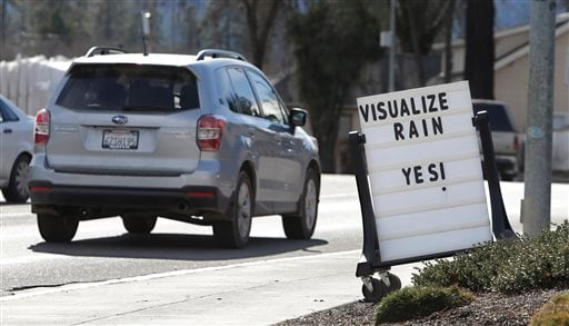FILE - In this Feb. 4, 2014 file photo, cars drive past a sign outside of a market reminding residents about the short water supply in Willits, Calif. (AP)