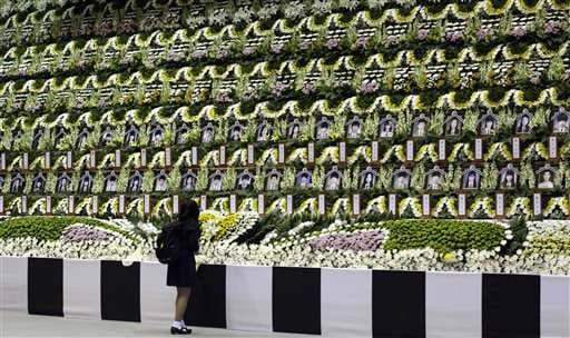 A girl pays tribute to the victims of the sunken ferry Sewol during a temporary memorial at the auditorium of the Olympic Memorial Museum in Ansan, south of Seoul, South Korea, Thursday, April 24, 2014. (AP)