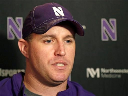 In this April 1, 2014, file photo, Northwestern football coach Pat Fitzgerald speaks at a news conference after his football team participated in an NCAA college spring practice in Evanston, Ill.