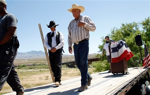 Rancher Cliven Bundy, center, walks off stage after speaking at a news conference near Bunkerville, Nev., Thursday, April 24, 2014. (AP)