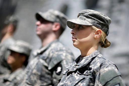 In this April 9, 2014 photo, West Point cadet Austen Boroff, right, of Chatham, N.J., stands in formation with others, as she waits to march to lunch at the United States Military Academy in West Point, N.Y.
