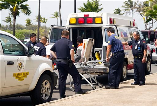In this April 20, 2014 file photo, a 15-year-old boy, seen sitting on a stretcher center, who stowed away in the wheel well of a flight from San Jose, Calif., to Maui is loaded into an ambulance at Kahului Airport in Kahului, Maui, Hawaii.