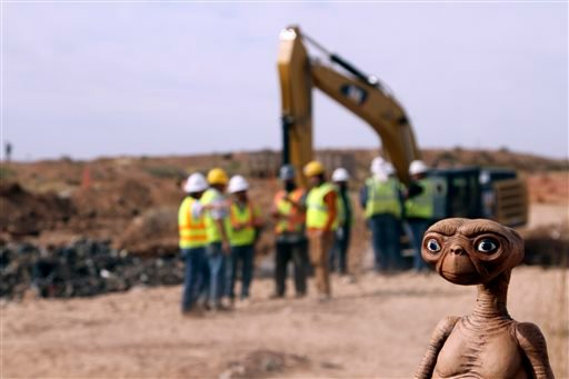 An E.T. doll is seen while construction workers prepare to dig into a landfill in Alamogordo, N.M., Saturday, April 26, 2014.
