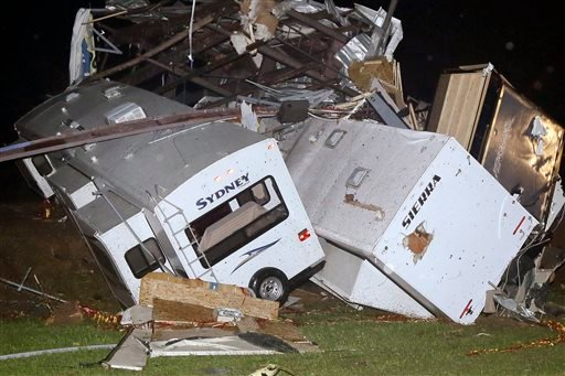 Travel trailers and motor homes are piled on top of each other at Mayflower RV in Mayflower, Ark., Sunday, April 27, 2014.