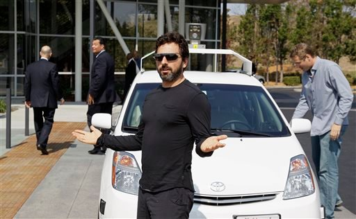 In this Sept. 25, 2012, file photo, Google co-founder Sergey Brin gestures after riding in a driverless car with officials, to a bill signing for driverless cars at Google headquarters in Mountain View, Calif.