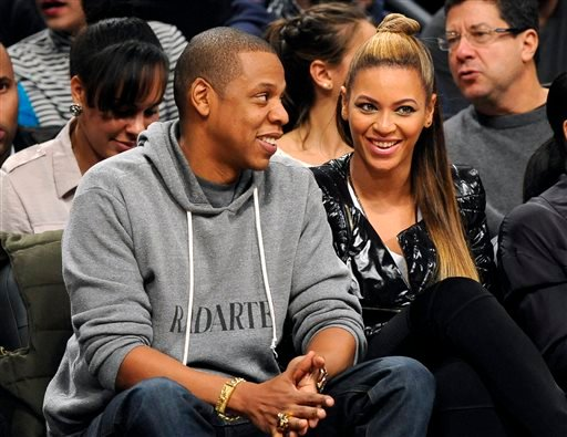 This Nov. 23, 2012 file photo shows entertainers Jay Z and his wife Beyonce at the Brooklyn Nets against the Los Angeles Clippers NBA basketball game at Barclays Center in New York.