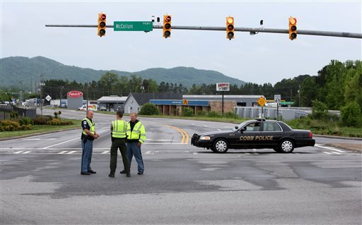 Cobb County Police block off Old US 41 Highway after an early morning workplace shooting at the Airport Road FedEx facility Tuesday April 29, 2014, in Kennesaw, Ga.