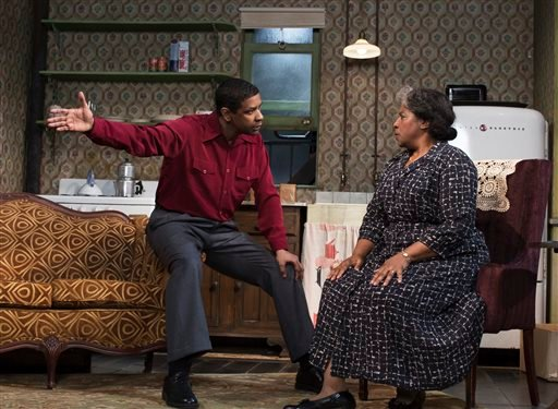 "This file image released by Philip Rinaldi Publicity shows Denzel Washington, left, and LaTanya Richardson Jackson during a performance of ""A Raisin in the Sun,"" at the Ethel Barrymore Theatre in New York."