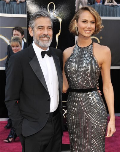 In this Feb. 24, 2013 file photo, actor George Clooney, left, and Stacy Keibler arrive at the Oscars at the Dolby Theatre in Los Angeles.
