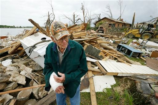 Louie Short walks through rubble that is all that is left of his Mayflower, Ark., home Tuesday, April 29, 2014. (AP Photo/Danny Johnston)