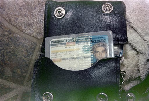 FILE - This April 1994 photo from the Seattle Police Department shows a wallet containing Kurt Cobain's Washington state driver's license, found at the scene of his suicide, in Seattle. (AP)