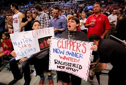 Fans hold up signs in support of the Los Angeles Clippers before Game 5 of an opening-round NBA basketball playoff series between the Clippers and the Golden State Warriors on Tuesday, April 29, 2014, in Los Angeles.
