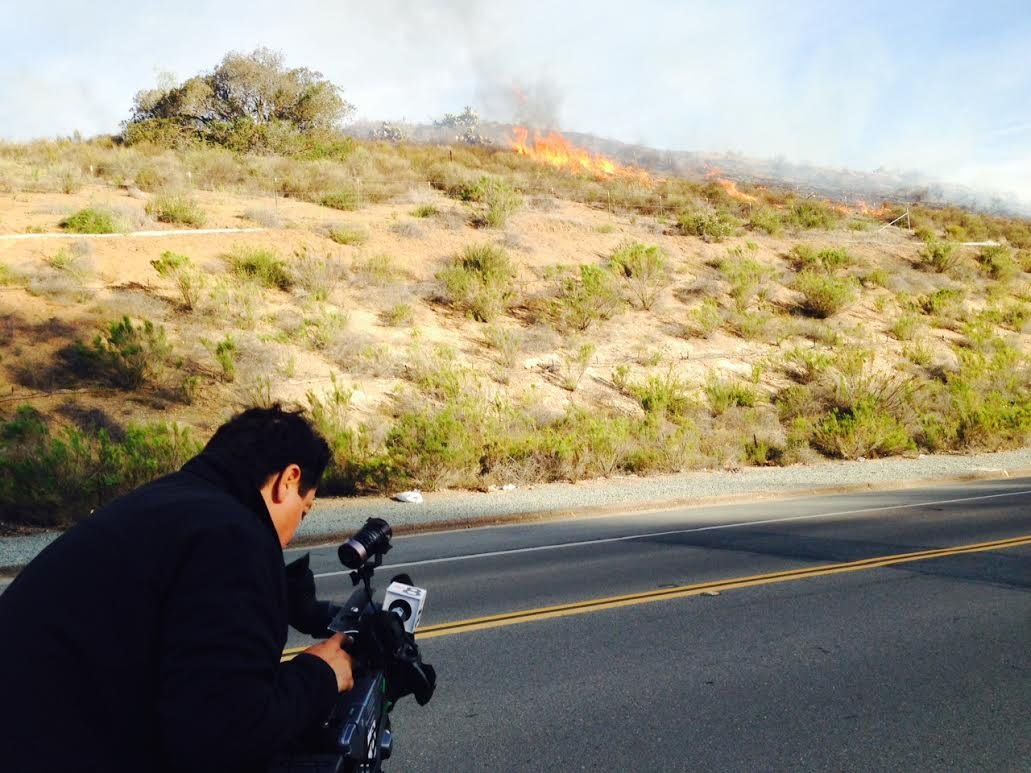 CBS News 8 Photographer Julio Vazquez shooting video of Lakeside brush fire Thursday, May 1.