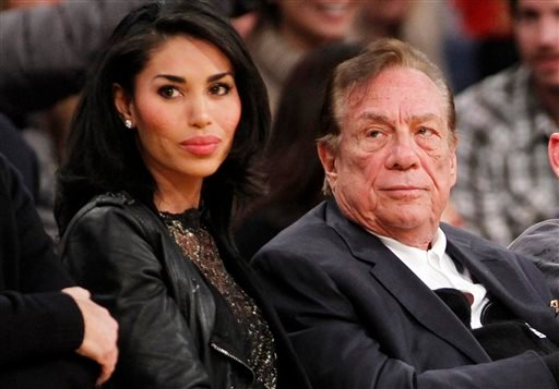 In this Dec. 19, 2010, file photo, Los Angeles Clippers owner Donald Sterling, right, and V. Stiviano, left, watch the Clippers play the Los Angeles Lakers during an NBA preseason basketball game in Los Angeles.