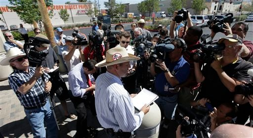 Ammon Bundy, son of rancher Cliven Bundy talks to the media about a criminal complaint he is going to file against the Bureau of Land Management at Metropolitan Police Department headquarters Friday, May 2, 2014 in Las Vegas. (AP)