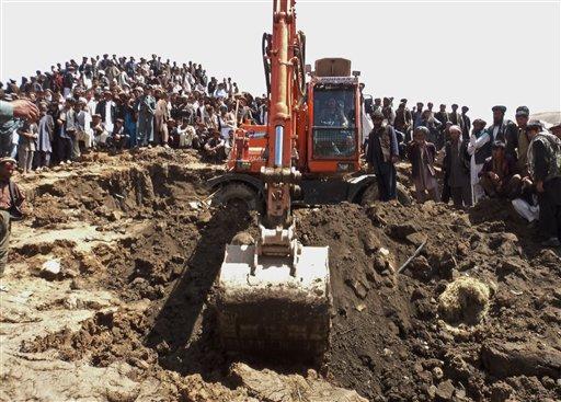 Afghans search for survivors after Friday's landslide buried Abi-Barik village in Badakhshan province, northeastern Afghanistan, Saturday, May 3, 2014.