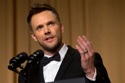 Actor and comedian Joel McHale makes jokes at the centennial dinner of the White House Correspondents' Association (WHCA) at the Washington Hilton Hotel, Saturday, May 3, 2014, in Washington. (AP Photo/Jacquelyn Martin)