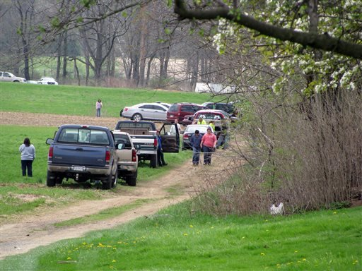 This was the scene Saturday, May 3, 2014, as state police notified the families of two adults and three children who were found dead in a cabin in rural Washington Township by a friend sometime in the late morning.