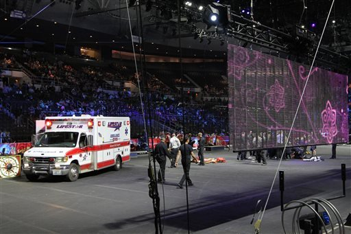 First responders work at the center ring after a platform collapsed during an aerial hair-hanging stunt at the Ringling Brothers and Barnum and Bailey Circus, Sunday, May 4, 2014, in Providence, R.I.