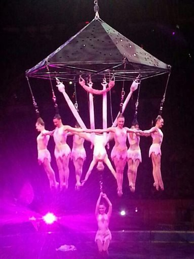 In this photo provided by Frank Caprio, performers hang during an aerial hair-hanging stunt at the Ringling Brothers and Barnum and Bailey Circus, Friday, May 2, 2104, in Providence, R.I.