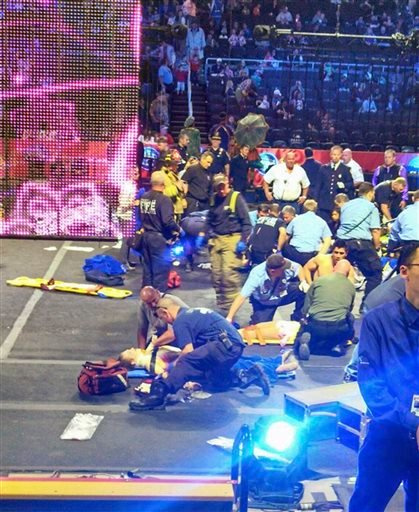 In this photo provided by Rosa Viveiros, first responders work at the center ring after a platform collapsed during an aerial hair-hanging stunt at the Ringling Brothers and Barnum and Bailey Circus, Sunday, May 4, 2014, in Providence, R.I.