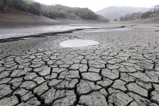 This Feb. 7, 2014, file photo shows the cracked-dry bed of the Almaden Reservoir in San Jose, Calif.
