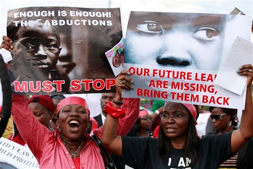 Women attend a demonstration calling on the government to rescue kidnapped school girls of a government secondary school Chibok, in Lagos, Nigeria, Monday May 5, 2014.