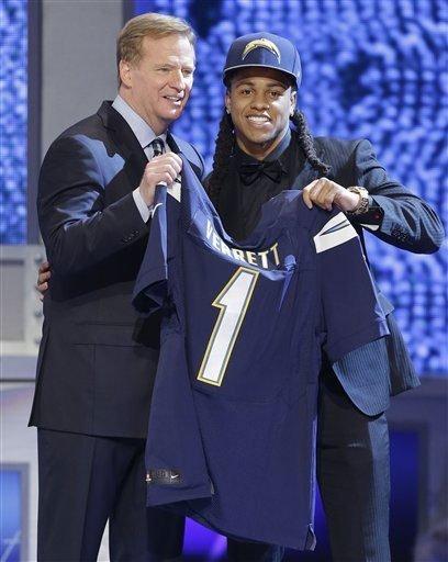 Texas Christian cornerback Jason Verrett poses with NFL commissioner Roger Goodell after being selected by the San Diego Chargers as the 25th pick of the first round of the 2014 NFL Draft, Thursday, May 8, 2014, in New York.