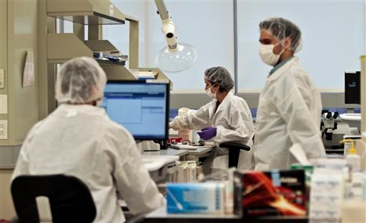In this April 15, 2014 photo, criminalist trainees work at a lab in the Office of Chief Medical Examiner in New York.