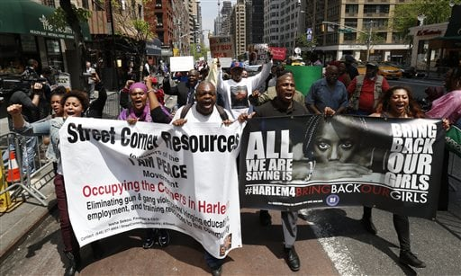 Demonstrators arrive in front of the Nigerian consulate after marching from Harlem during a rally, Saturday, May 10, 2014, in New York.