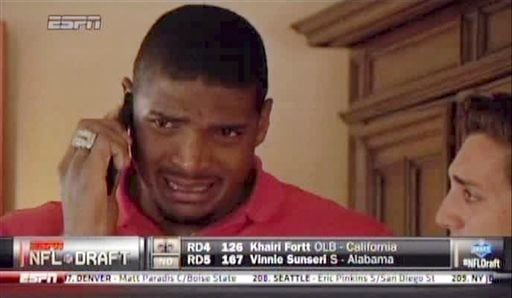 In this image taken from video, Missouri defensive end Michael Sam cries as he talks on a mobile phone at a draft party in San Diego, after he was selected in the seventh round, 249th overall, by the St. Louis Rams in the NFL draft Saturday, May 10, 2014.