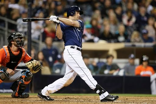 San Diego Padres' Seth Smith hits a double in the seventh inning against the Miami Marlins during a baseball game Saturday, May 10, 2014, in San Diego. As of the seventh inning, Smith had hit a home run, triple and a double. (AP Photo/Gregory Bull)