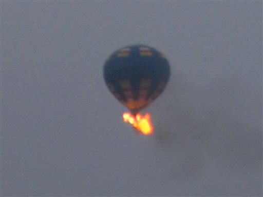This photo provided by Nancy Johnson shows what authorities say is a hot-air balloon that was believed to have caught fire and crashed in Virginia, Friday, May 9, 2014.