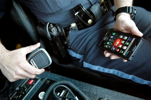 With 6 billion text messages exchanged daily in the United States, texting is becoming a more frequent part of police crisis negotiations. (AP Photo/Mark Bugnaski)