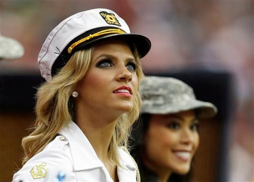 In this Nov. 17, 2013, file photo, Houston Texans cheerleader Caitlyn watches from the sideline during the second half of an NFL football game against the Oakland Raiders in Houston.