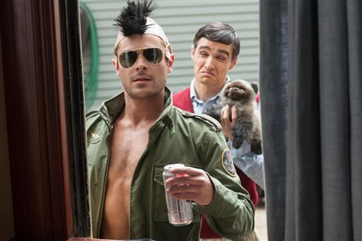 """This image released by Universal Pictures shows Zac Efron, left, and Dave Franco in a scene from """"Neighbors."""" (AP Photo/Universal Pictures, Glen Wilson)"""
