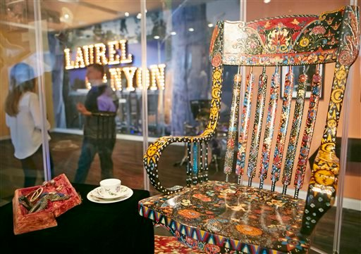 """In this Friday, May 9, 2014 photo, Grammy Museum Executive Director Bob Santelli, left, comments of The Mamas & the Papas singer Cass Elliot's chair, left, on display at the Grammy Museum exhibit """"California Dreamin."""""""